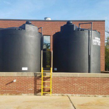 12,150 IMFO Tanks with F.S. 2650 Manway Covers Storing Sodium Hypochlorite